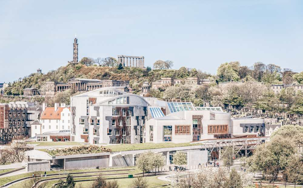 Things to see in Edinburgh: The interesting design of the new building of the Scottish Parliament, one of the main attractions on this Edinburgh walking tour.