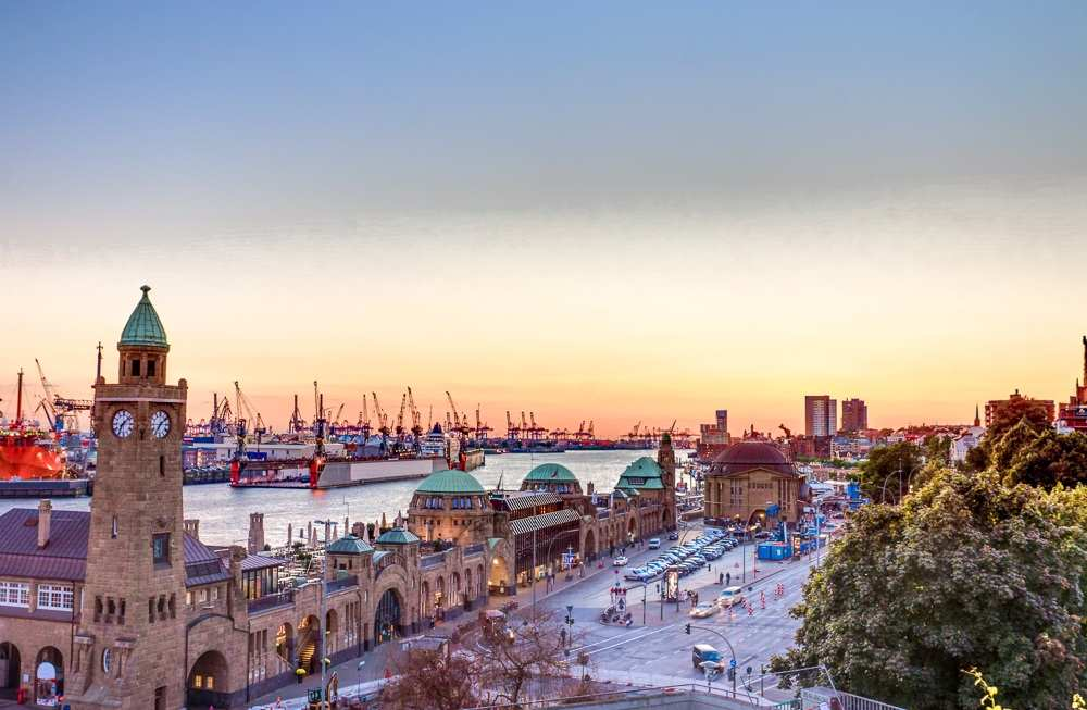 Things to see in Hamburg: View of the iconic St. Pauli Landing Bridges at sunset, one of the best things to see when spending 24 hours in Hamburg.