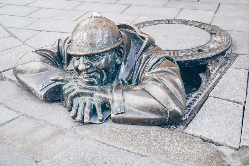 Bratislava Statues: Čumil (The Watcher). This quirky statue, erected in 1997, features an amusing chap peeping out of an imaginary sewer hole. He is the most photographed sight in Bratislava.