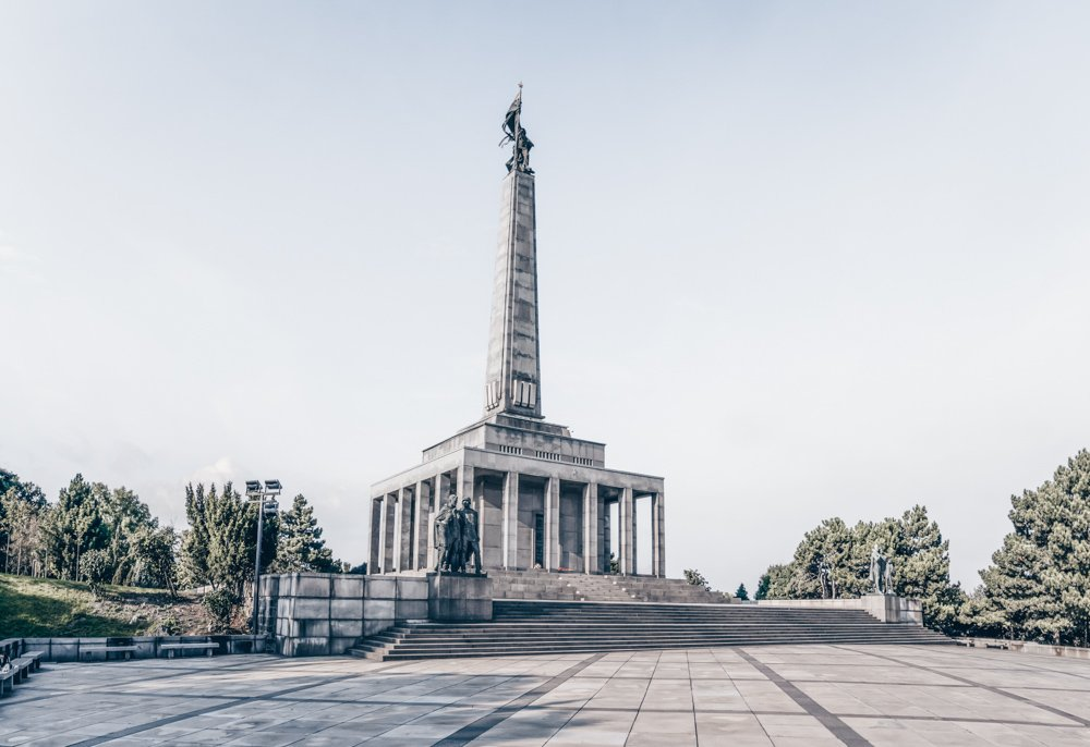 Must-see sights in Bratislava: View of the Slavin Memorial that pays tribute to the thousands of Soviet soldiers killed in battles with the Nazis around Bratislava in the latter stages of World War II. Its 40-meter obelisk is topped by a bronze figure of a Red Army soldier holding a banner.