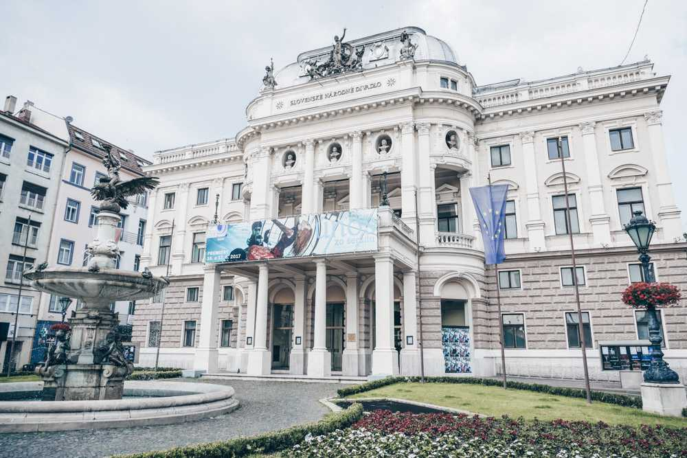 Free self-guided Bratislava walking tour: View of the beautiful Neo-Renaissance facade of the Old Slovak Theater and the lovely Ganymede fountain.