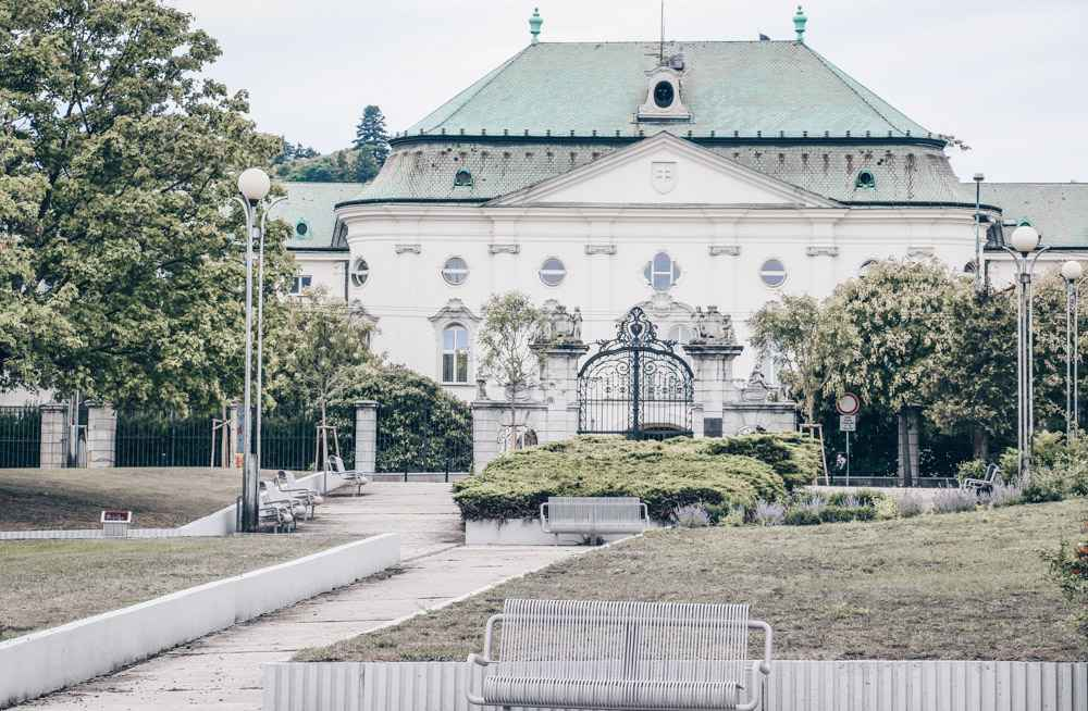 Free self-guided Bratislava walking tour: View of the Baroque-style Archbishop's Summer Palace, home to  Office of the Government of the Slovakia. PC: Fred Romero from Paris, France [CC BY 2.0 (https://creativecommons.org/licenses/by/2.0)], via Wikimedia Commons.