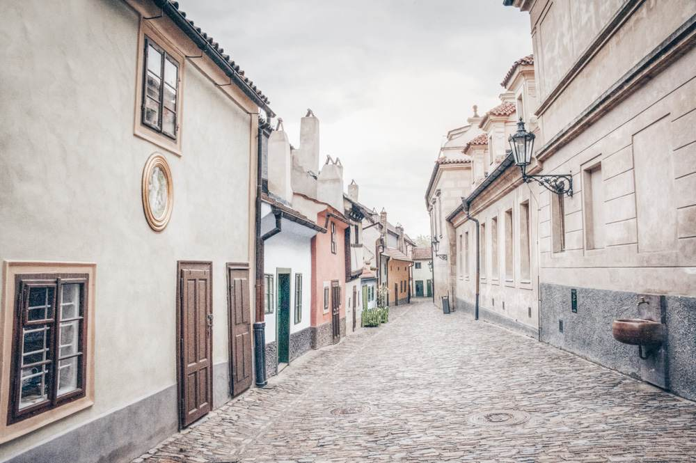 Instagrammable places in Prague: View of the brightly painted, ramshackle historic cottages in the Golden Lane within the Prague Castle.