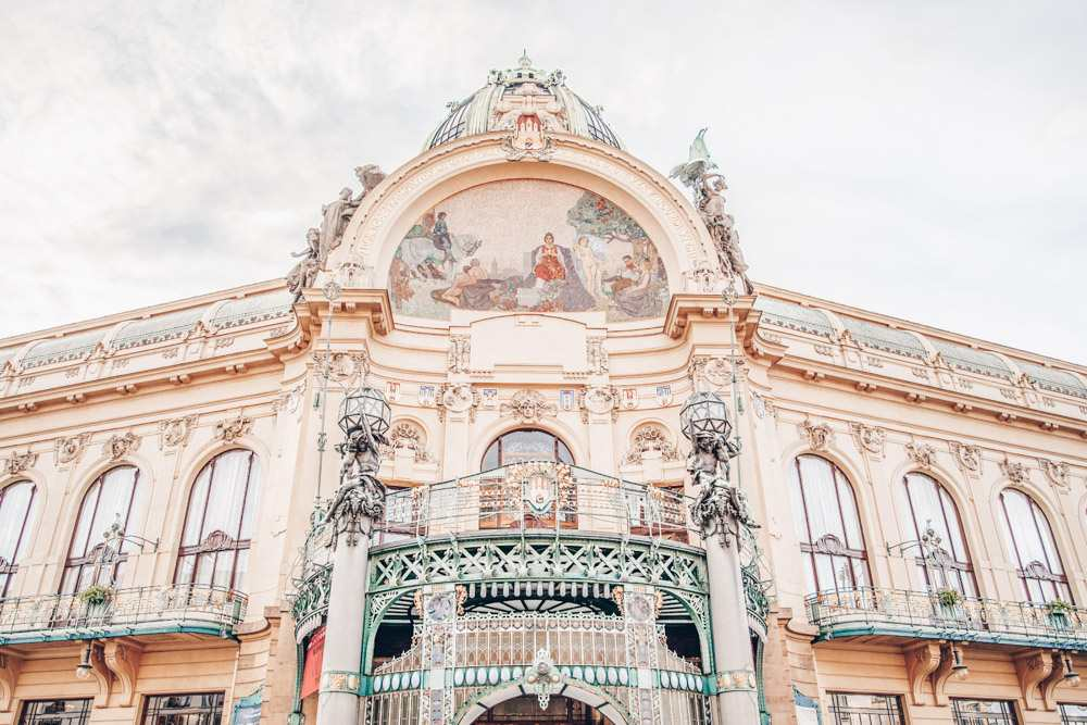Prague architecture: View of the resplendent Art Nouveau style Municipal House that is embellished with mosaics, stucco and allegorical statuary. It is now a center for concerts, rotating art exhibits, and café society