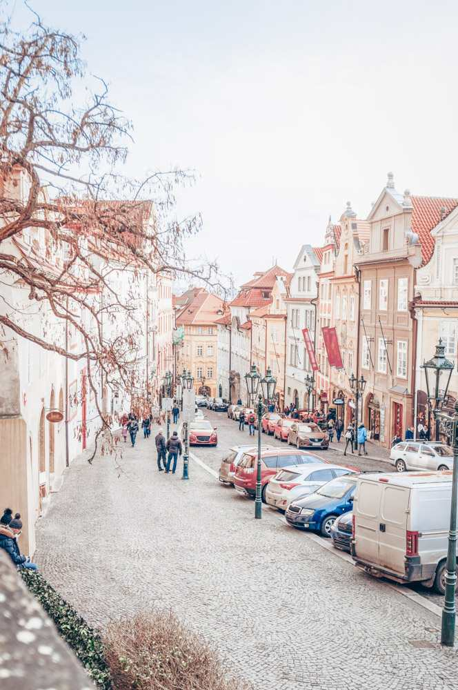 Prague on foot: View of the pastel-hued Baroque buildings on Nerudova Street in the Lesser Quarter of Prague.