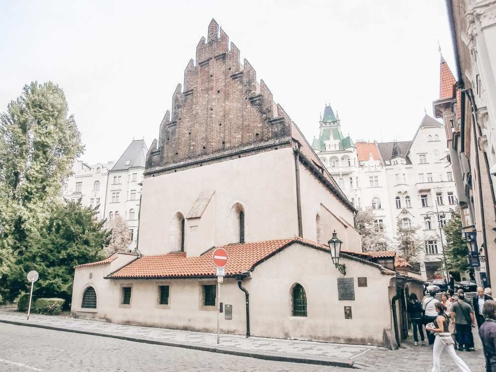 Free Prague walking tour: View of the Gothic-style Old-New Synagogue, Prague's oldest surviving synagogue that is easily recognizable by its steep, sawtooth gables.