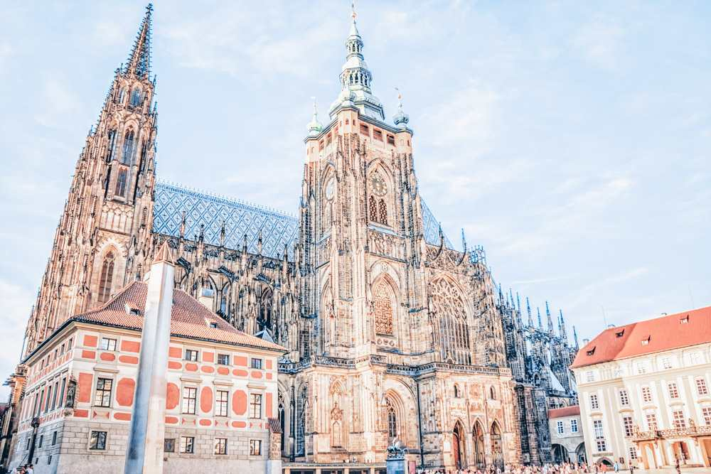 Free Prague walking tour: View of the famous St. Vitus Cathedral which features pointed arches, flying buttresses, and gargoyles. It is one of the must-see sights in Prague.