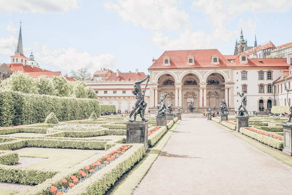 Prague sightseeing: View of the Baroque Wallenstein Palace & gardens in the Lesser Quarter. The gardens are home to numerous fountains and statues depicting figures from classical mythology and are one of the top places to see in Prague.
