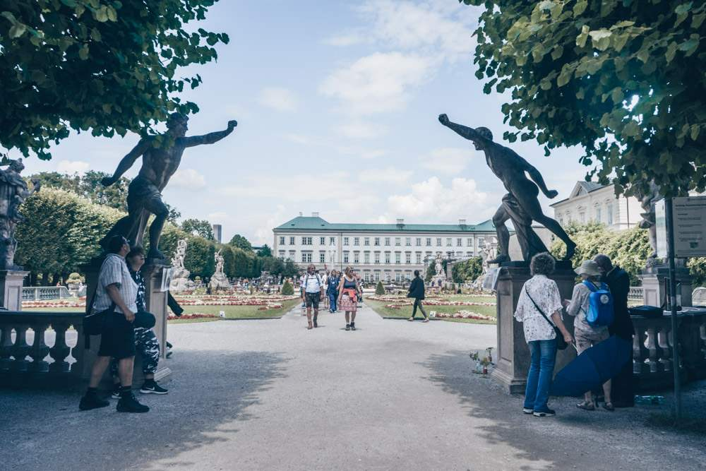 Maria and the children pose with these statues in one of the Sound of Music scenes filmed in Salzburg.
