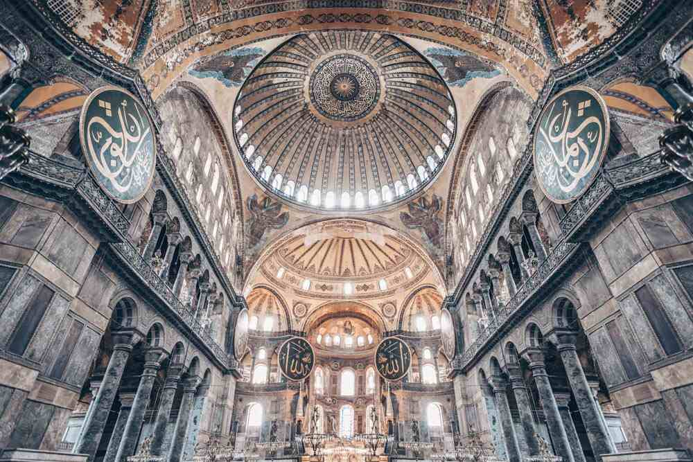 Things to do in Istanbul - Interior of Hagia Sophia decorated with mosaics and calligraphic discs. PC: saiko3p/shutterstock.com