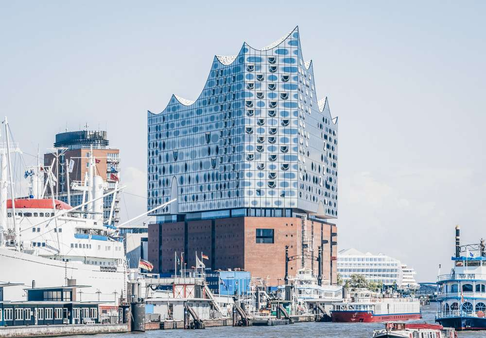Hamburg sightseeing - The dazzling Elbphilharmonie concert hall that resembles an undulating wave. PC: oscity/shutterstock.com
