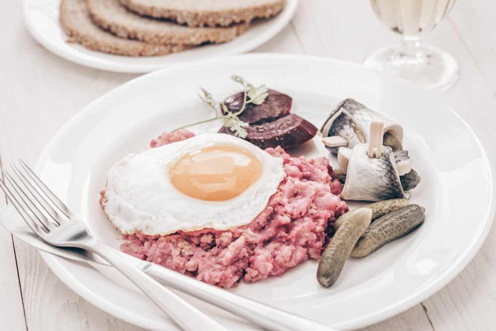 Hamburg food - Labskaus consists of chopped beef, potatoes, beetroot, pickles, salted herring topped with an egg
