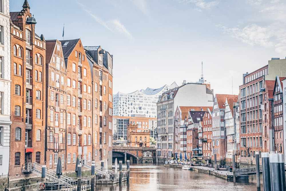 What to see in Hamburg - Historic houses on the gently curving Nikolaifleet with Elbphilharmonie in the background.
