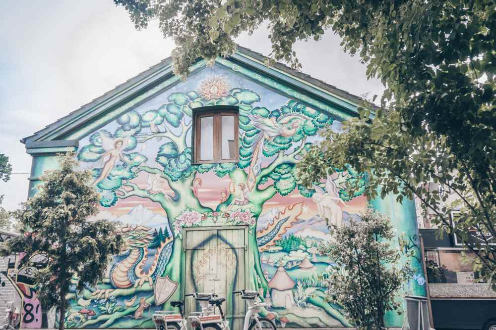 Copenhagen Christiania: Colorful mural painted on the side of a building