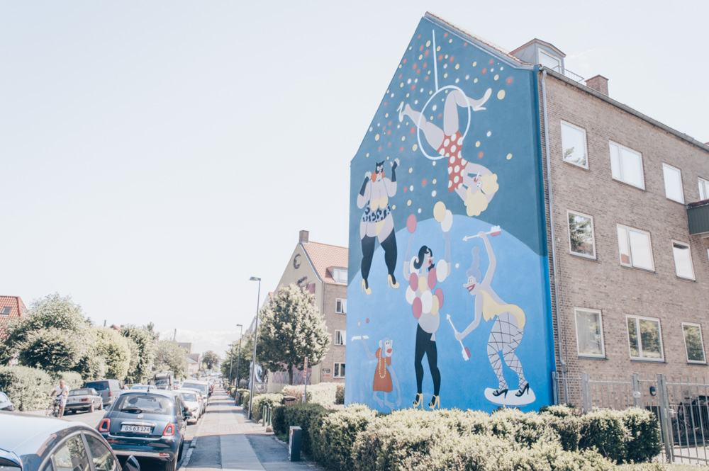 Copenhagen street art: A colorful mural on the side of building in Nørrebro
