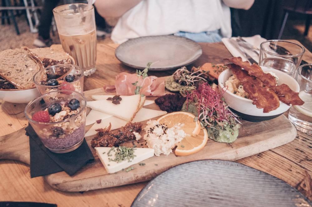 2 Days in Copenhagen: Breakfast platter consisting of cheeses, bacon, porridge, bread