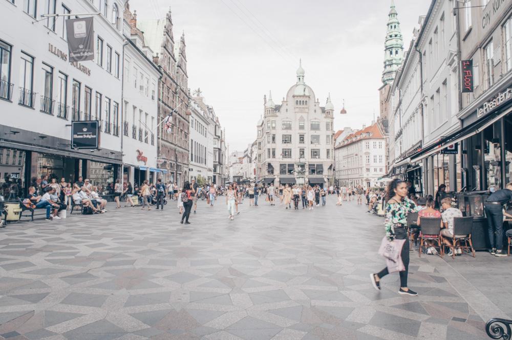 Copenhagen shopping: People walking on the pedestrianized Strøget shopping street