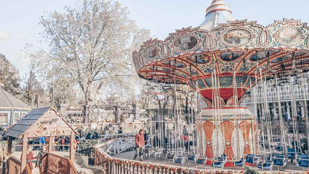 Copenhagen sightseeing: People riding the rides at Tivoli Gardens