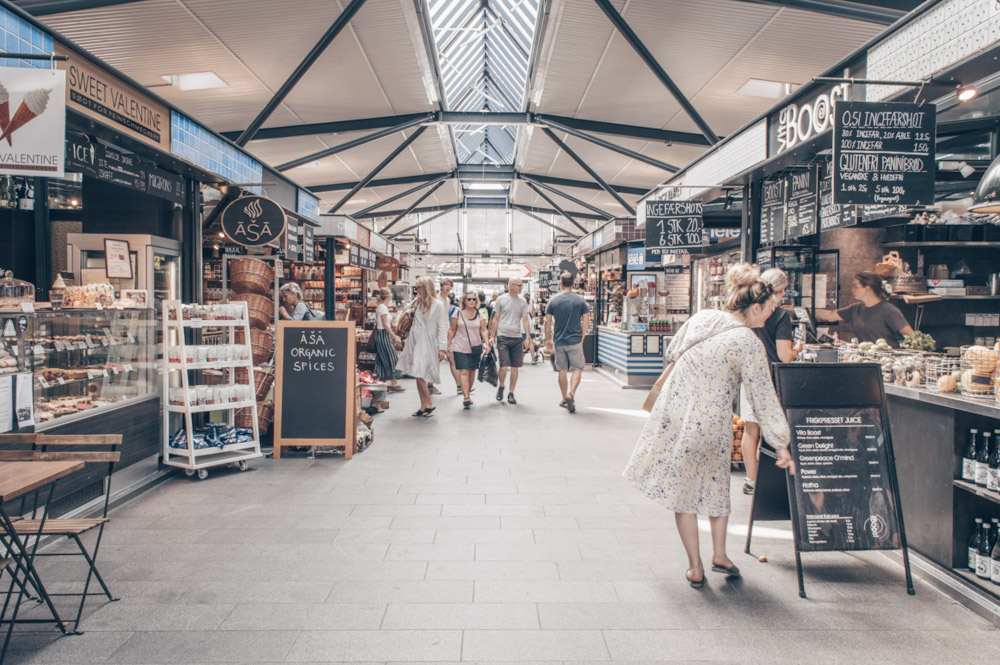 Things to do in Copenhagen: People inside the popular Torvehallerne Food Market