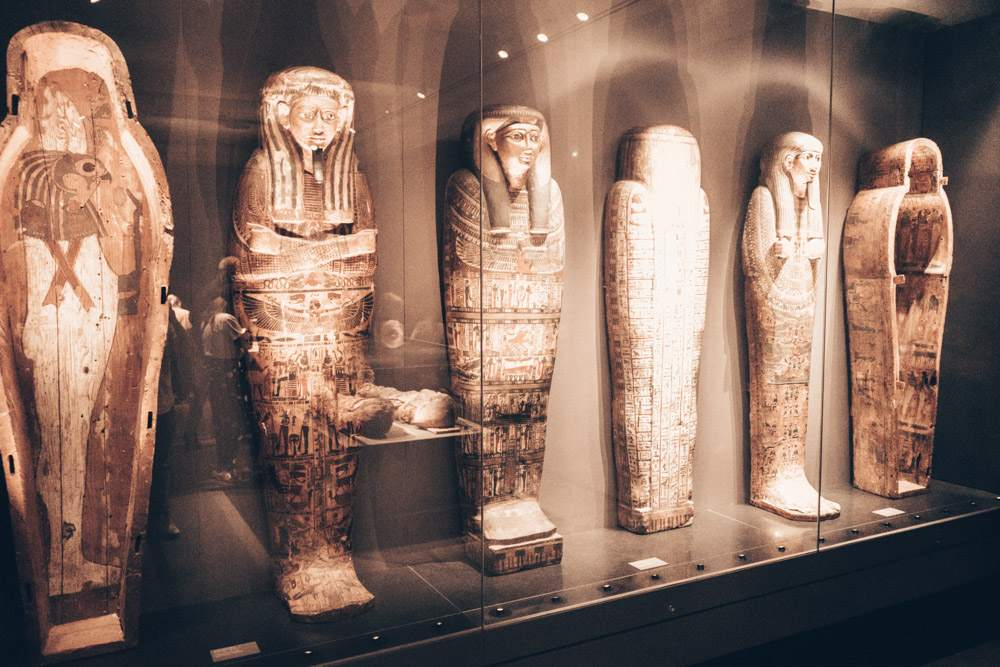 Ny Carlsberg Glyptotek Copenhagen: Ancient Egyptian mummies on display in a glass cabinet