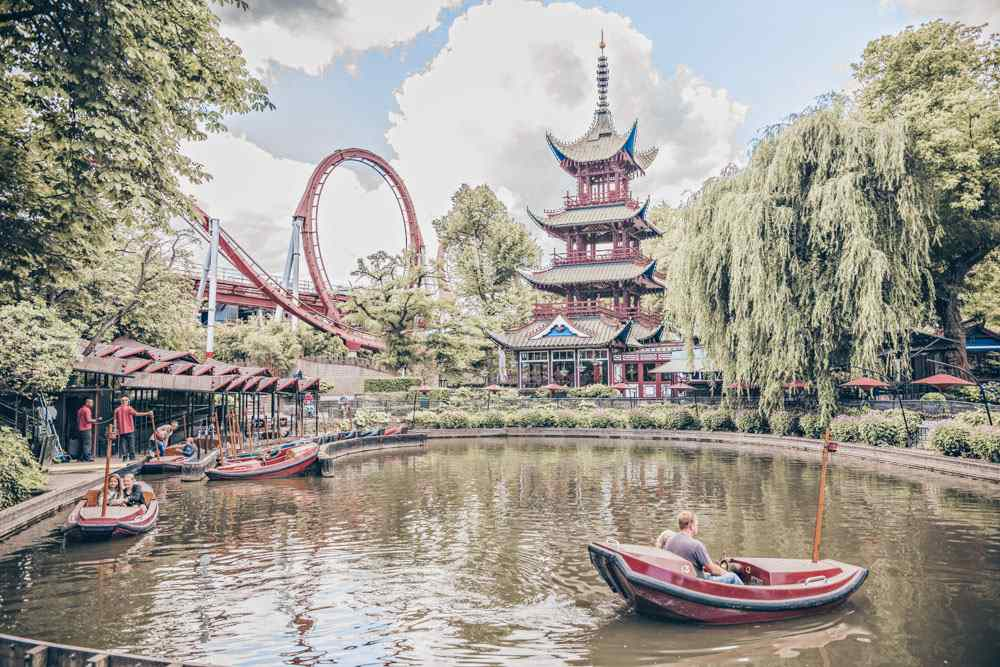 Must-see Copenhagen: Panoramic view of the rides, Chinese pagoda and Tivoli lake in Tivoli Gardens. PC: Sun_Shine/shutterstock.com