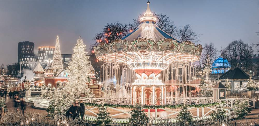 Copenhagen sightseeing: Panoramic view of the Tivoli Gardens lit up at night