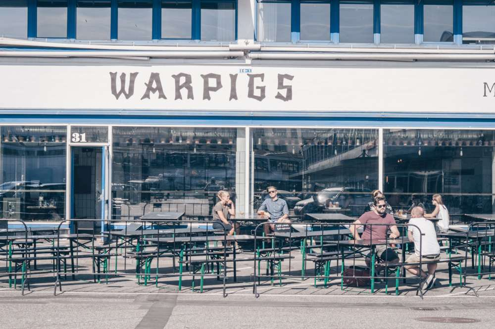 Copenhagen Meatpacking District: People sitting outside the Warpigs brewpub