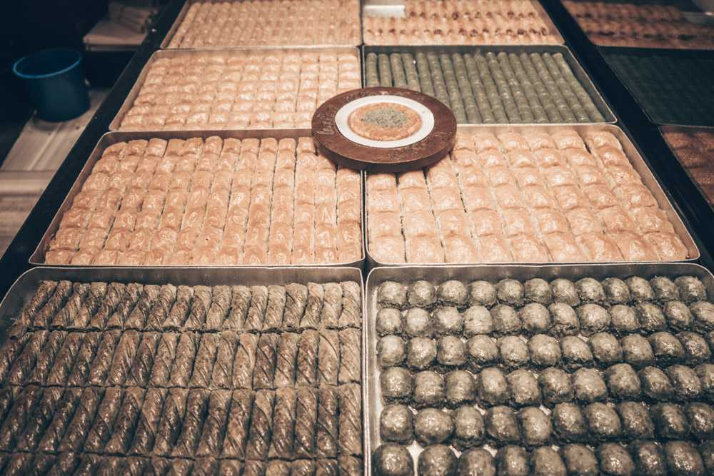 What to eat in Istanbul: Trays with numerous kinds of baklava (flaky pastry drenched in syrup).