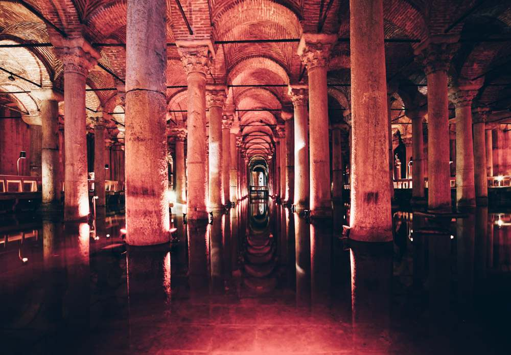 Istanbul sightseeing: The cavernous interior of the Basilica Cistern with elaborate arches and columns.