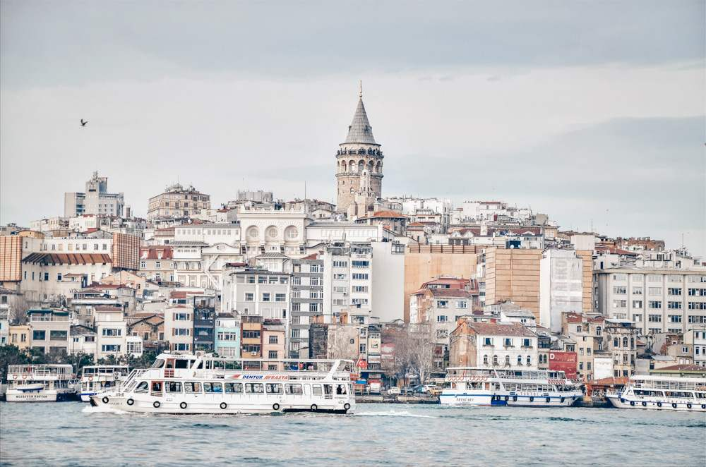 Istanbul ferry: Cruise ships in the Bosphorus with Beyoglu and Galata Tower in the background.