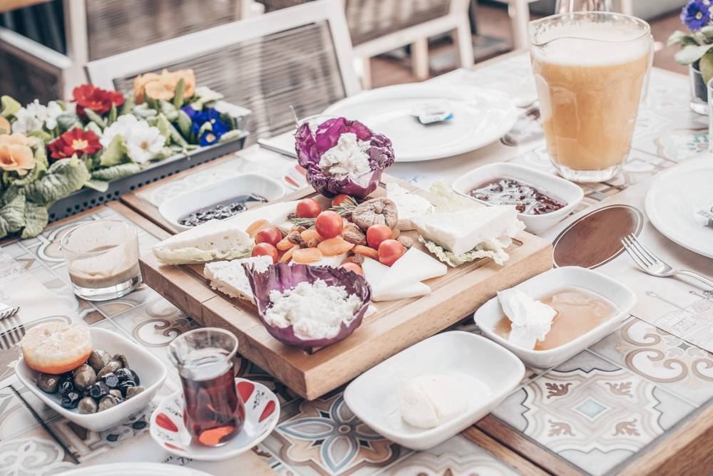 Things to do in Istanbul: Turkish Breakfast of tea, olives, cheeses, jams, honey and clotted cream.