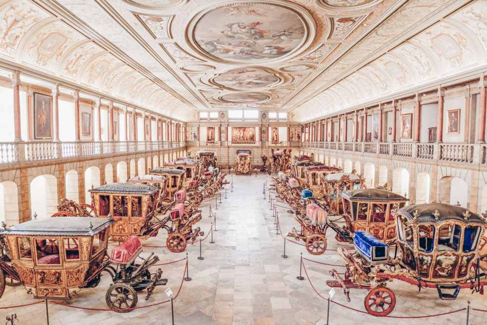 Lisbon Museums: Numerous ceremonial coaches inside the National Coach Museum. PC: StockPhotosArt/shutterstock.com
