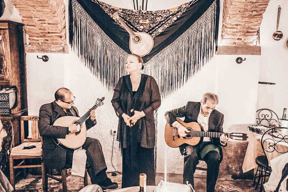 Fado in Lisbon: Two guitarists accompanied by a woman singing fado melodies. PC: amnat30/shutterstock.com