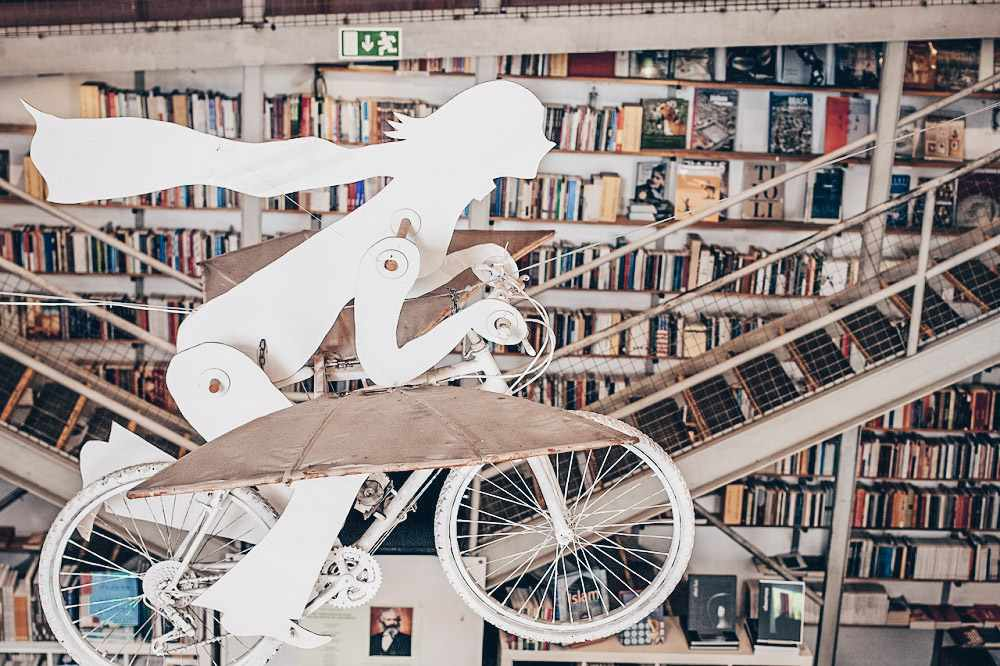 Offbeat things to do in Lisbon: Suspended bicycle at bookstore in the LX Factory.