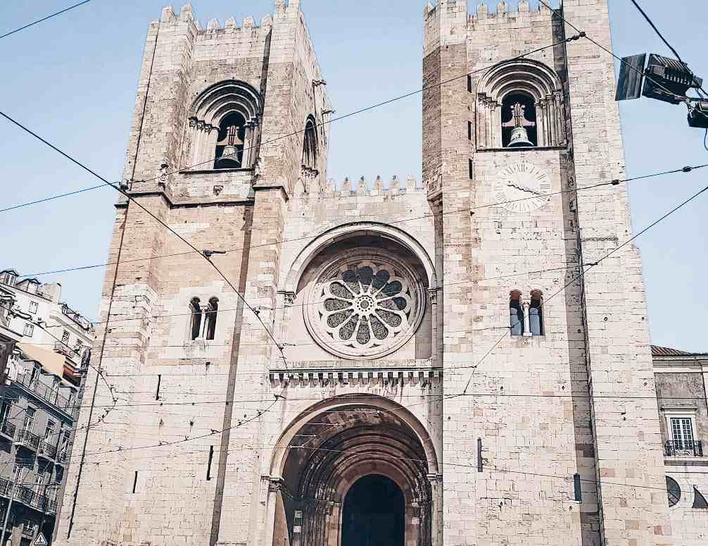 3 Days in Lisbon: Crenelated towers and rose window of the facade of Lisbon Cathedral.