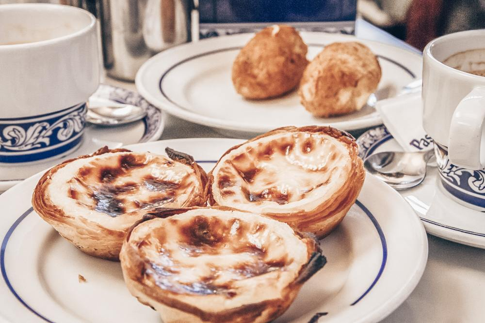 What to eat in Lisbon: Pieces of the famous Pastel del nata.