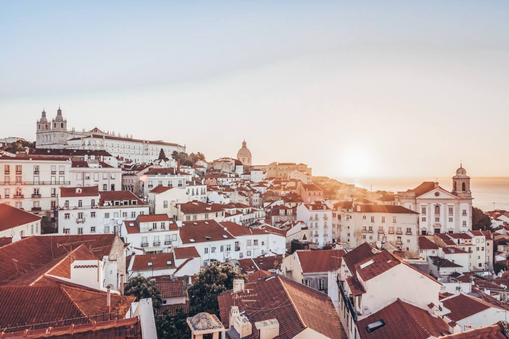 Things to see in Lisbon: Panoramic view of the Alfama district at sunset
