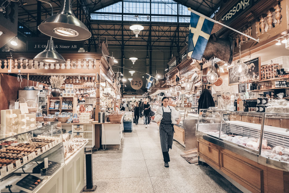 Places to visit in Stockholm: People in the interior of Östermalm Food Hall. PC: Rolf_52/shutterstock.com