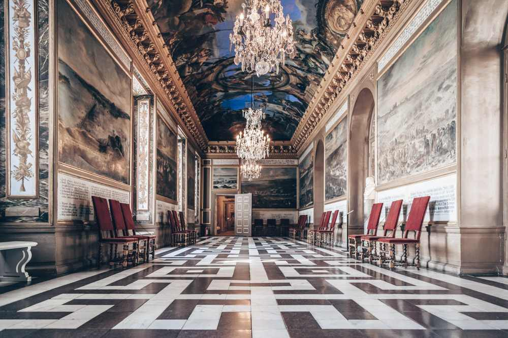 Drottningholm Palace: Paintings of historical events inside Karl XI's Gallery. PC: Uwe Aranas/shutterstock.com