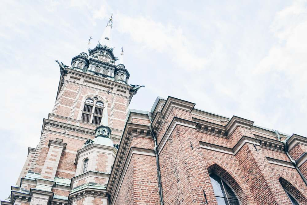 Things to see in Stockholm: Exterior of the copper-roofed red-brick German Church in Gamla Stan (Old Town)