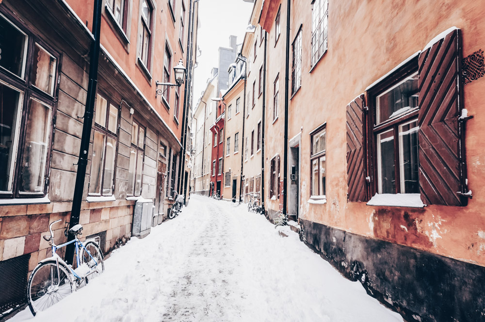 Stockholm must-see attractions: Snow covered cobblestone street of Prästgatan in Gamla Stan (Old Town)