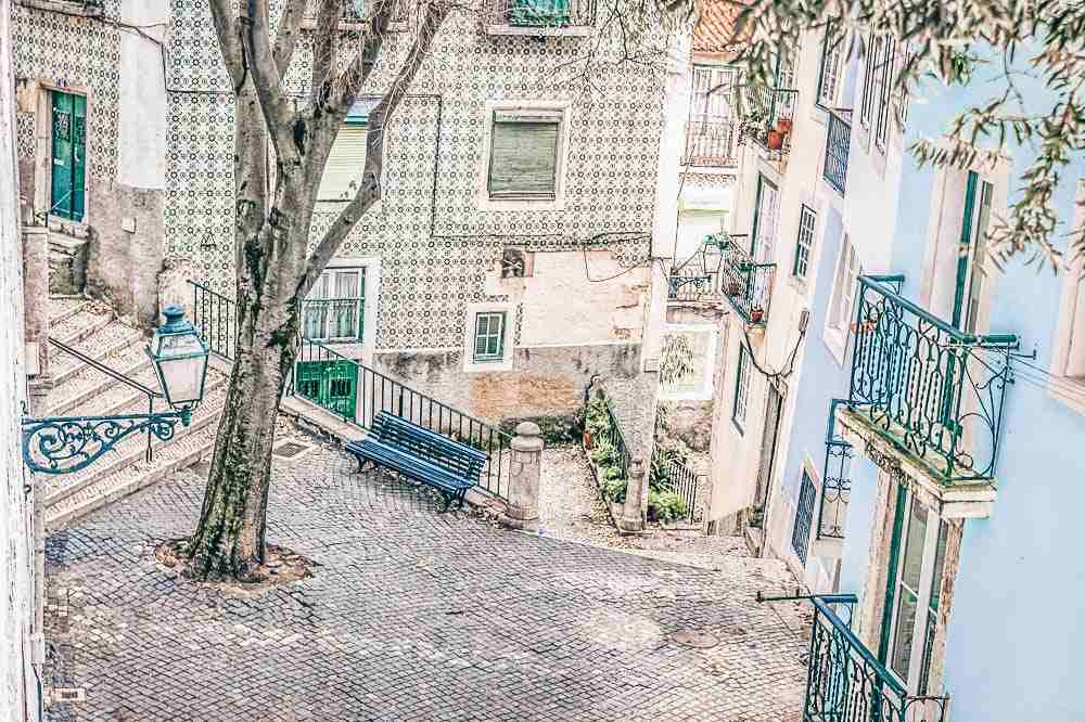 3 Days in Lisbon - A colorful cobbled courtyard in the Alfama district.