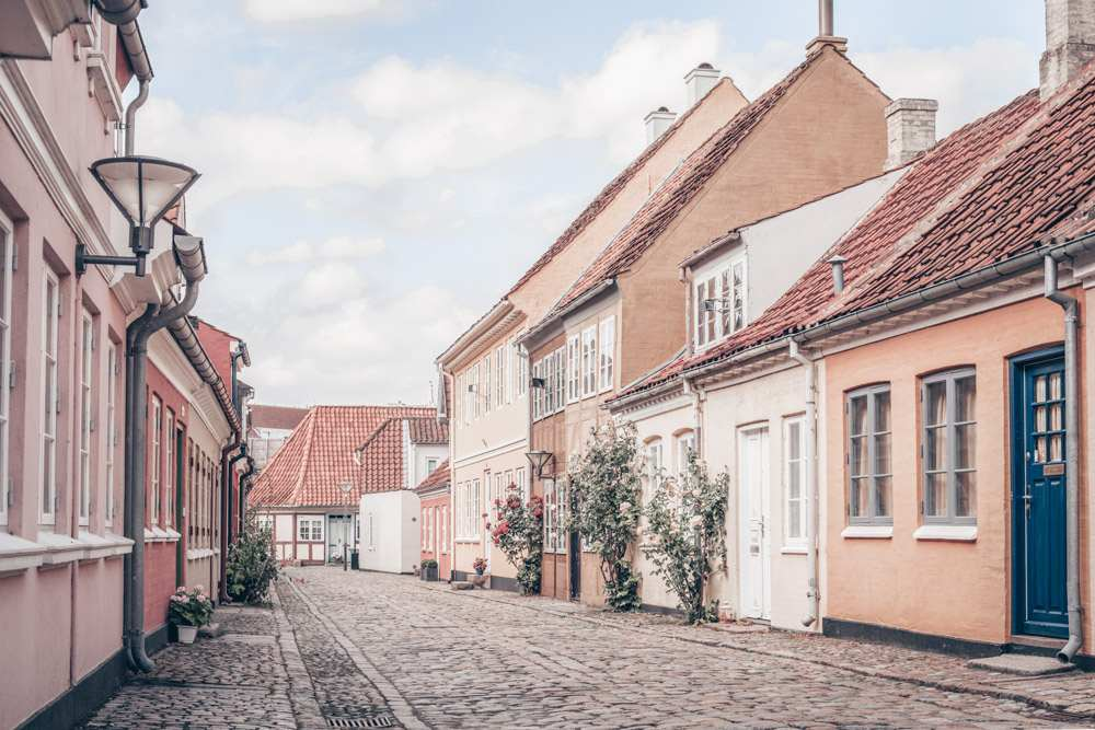 Places to visit in Denmark: Pastel-colored houses in the old town of Odense