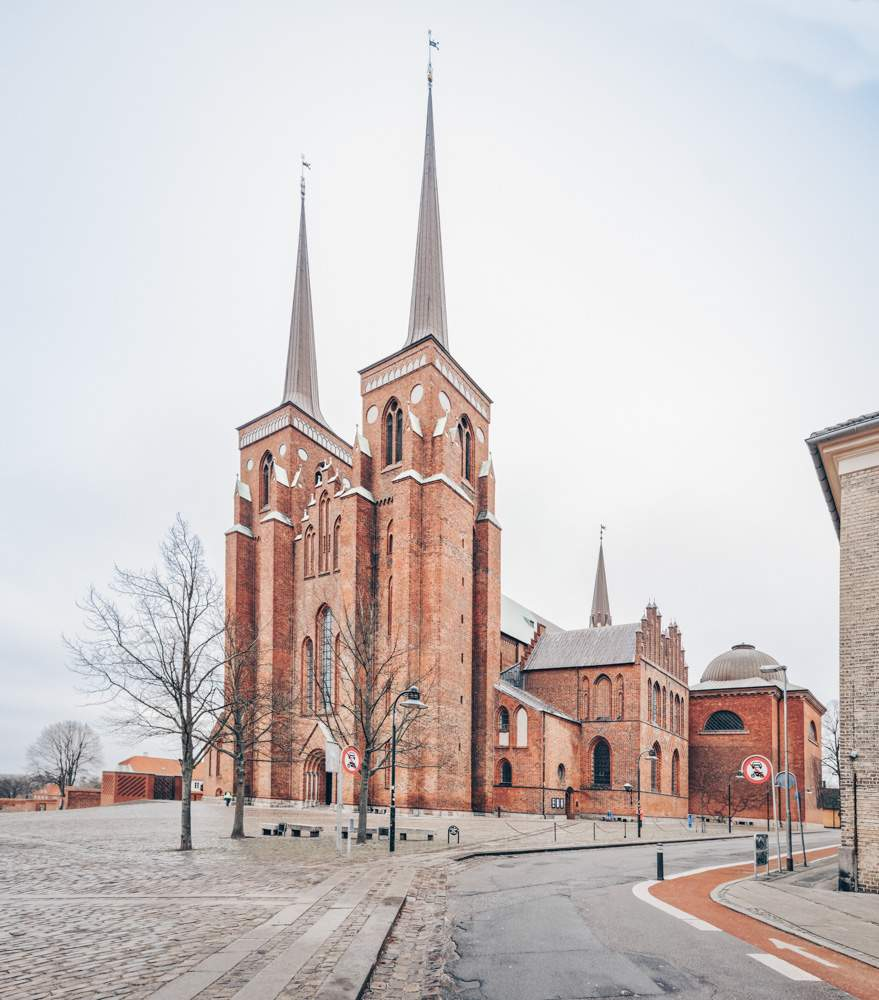 Places to see in Denmark: The famous red-brick Roskilde Cathedral. PC: StockphotoVideo/shutterstock.com