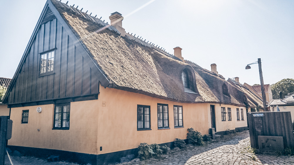 Day Trips from Copenhagen: A cottage with a thatched roof on a quiet street in Dragør