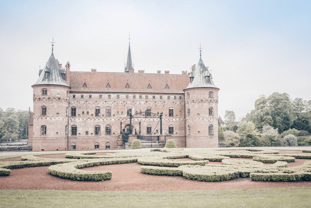 Places to see in Denmark: Exterior of the moated fairy-tale like Egeskov Castle
