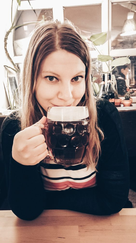 24 Hours in Prague: Beautiful woman sipping beer in a restaurant