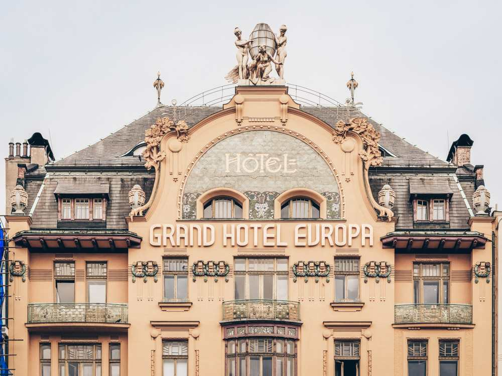Prague architecture: Ornate Art Nouveau facade of Grand Hotel Europa with gilded nymphs