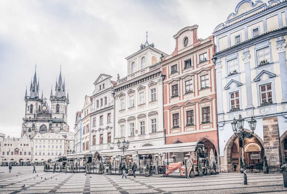 Prague Old Town Square: An array of colorful historic buildings with the Tyn Church in the background