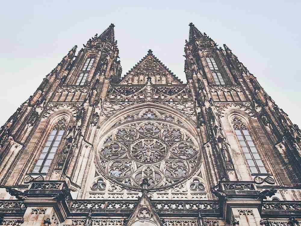 What to see in Prague: The ornate facade of St. Vitus Cathedral with pointed arches, and a rose window